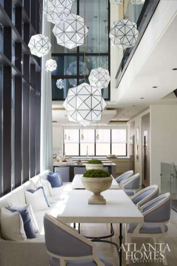 Pendant lights from Restoration Hardware dance in the atrium space and above the dining area of this New Orleans townhome.