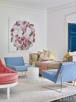 Interior designer Clary Bosbyshell incorporated the homeowner's favorite color, a soft hydrangea blue, into furnishings like the metal frame chairs by Lawson Fenning. The chaise is Hickory Chair and the rug is Stark Carpet. The artwork is by Nancy Richardson, represented by Voltz Clarke Gallery in New York. Throw, R. Hughes.