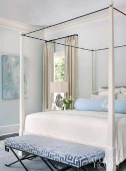 In the master bedroom, a David Iatesta bed features bedding from Leontine Linens. The drapery fabric is JAB and the trim is Travers. The abstract is by Blayne Macauley at Anne Irwin Fine Art.