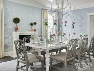 In the dining room, a high-gloss ceiling complements a chinoiserie wallpaper by Paul Montgomery through Travis & Company. The table and chandelier are David Iatesta through Ainsworth-Noah.
