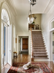 Wood planking softens the home's formality. Carter Kay and Nancy Hooff opted to keep the millwork and walls one color, allowing the molding to become part of the architecture.