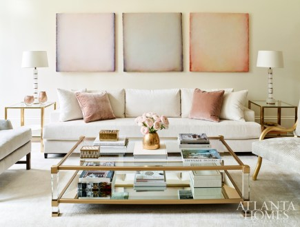 A trio of oil paintings on canvas by Katharina Chapuis from Pryor Fine Art introduce subtle pastel tones to the formal living room.