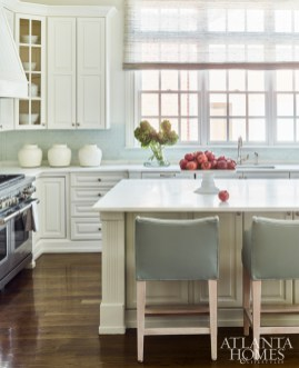 Statuary white marble countertops and newly painted cabinetry freshened up the already lovely kitchen without requiring a major renovation.