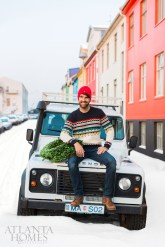 """Known for his love of saturated colors and extremely cold weather, Brian Patrick Flynn now calls one of Reykjavik's most colorful streets home. """"Iceland is known for its enthusiastic love of Christmas year-round, which makes shopping for holiday decor easy,"""" he says."""