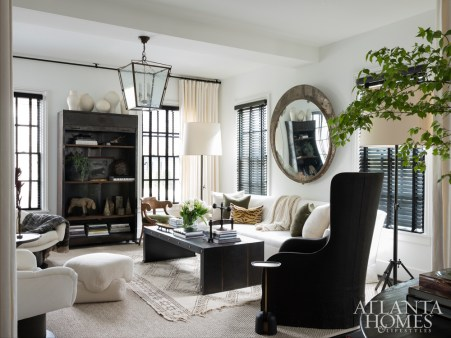 Interior designer Susan Ferrier, a confidante, suggested a 10-foot-long sofa, and Hughes subsequently selected Seine by Dmitriy & Co. The wing chair is Gregorius Pineo through Jerry Pair. The coffee table is Jean de Merry.