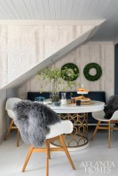For holiday dinners and New Year's cocktails and games, Flynn outfitted this spot with an armless banquette and an oversized pedestal table, both from Duralee. The chairs are IKEA, and the ceiling is Krypton by Sherwin-Williams.