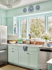 Seeking a kitchen that was light and bright, but not white, Lowe gave the small space a fresh new look with a coat of custom robin's-egg blue paint.