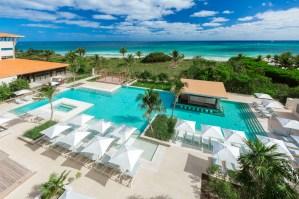 La Escondida, one of three pools at UNICO 20˚87˚ Hotel Riviera Maya, includes a hydro pool and plenty of seating.
