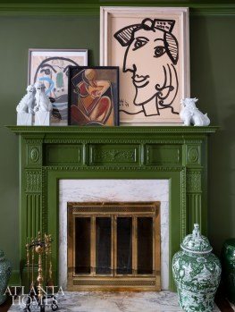 Cubist artwork and antique pottery read as one collection when grouped together.