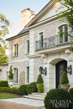This neoclassical French home by Harrison Design radiates a stately presence with materials that include limestone, wrought iron, stucco, sand-cast brick and cobblestone. The builder and general contractor was Brody Dernehl with The Dernehl Company.