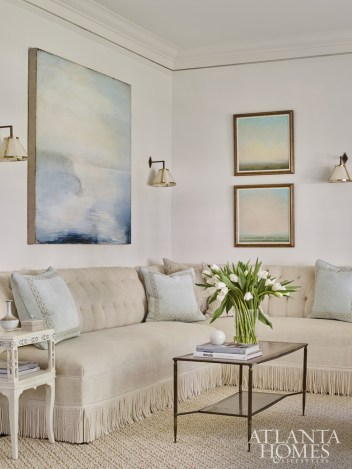 A banquette with bullion fringe adds formal flair. The art is by Shawn Dulaney and Michael Abrams, both through Sears Peyton Gallery.