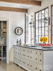 Windows in the galley-style kitchen capture beautiful natural light and open onto the home's backyard.