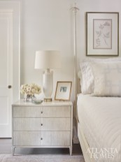 Envisioning a soft, tranquil retreat, the master bedroom features a slight nod to Swedish design, says Howard. The custom bed is by Stephen Plaud and the bedside table is Mr. and Mrs. Howard for Sherrill Furniture. A crystal chandelier by Niermann Weeks is through Ainsworth-Noah and the painting by artist Dusty Griffith is through Pryor Fine Art.