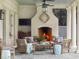 """""""We use the outdoor space all the time, and I love the bluestone floors,"""" says Hight. """"And the pool is great because my three children are all swimmers."""""""
