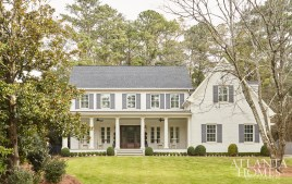 With an extensive front porch, the facade is in the style of an updated farmhouse.