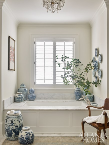 DeLoach incorporated pops of blue and white porcelain in the master bath.