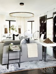 A peek into the master lounge reveals custom chaises by Dmitriy, black-and-white art from South of Market and a Christopher Boots chandelier from R Hughes.