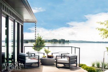 An intimate sitting area with chairs from RH offers a bird's-eye view of the spectacular setting.