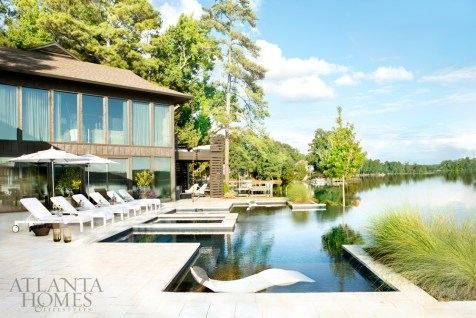 Outdoor rooms feature the same comforts as indoor living spaces. The lining of the new infinity pool was designed and colored so that its reflection would mimic the surrounding lake water. Chaises and umbrellas, RH. Lanterns, Dixon Rye.
