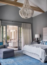An overdyed Oushak rug from Moattar, Ltd. serves as the foundation for the master bedroom's beach-inspired palette. A custom hanging bed located on the balcony also offers a breezy, coastal touch.