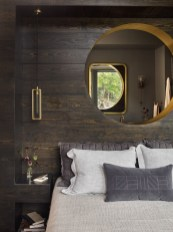 A custom brass-lined porthole and oculus evoke a nautical vibe.