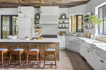 """Mindful of the homeowners' """"easy living"""" directive, Giles upholstered the kitchen stools by Palecek in a durable vinyl for quick cleaning."""
