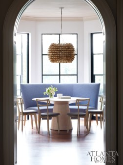 Douglass relocated the breakfast table to this bay window next to the kitchen. To add interest to the airy nook, she selected a raffia light fixture from South of Market.