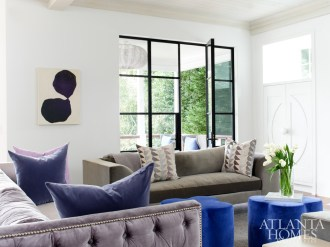 Plush seating makes the family room a cozy spot to gather. The clover ottomans are from South of Market and the artwork is by Susan Hable Smith.