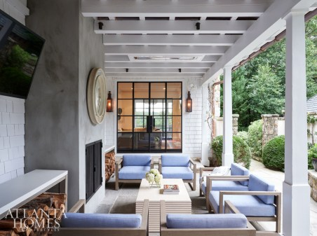 Located off the family room, the covered loggia features seating from Janus et Cie and a South of Market coffee table.