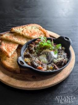 The Huevo Con Trufa features slow-braised pork cheeks, poached egg, black truffle pâté and sourdough.