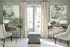 The lacquered library, inspired by a pair of Jenny Nelson paintings, is painted in Benjamin Moore's Puritan Gray. The upholstered desk chairs and ottoman are Charles Stewart.
