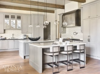 Customized by Design Galleria Kitchen & Bath Studio for the home's previous owners, the kitchen islands were refinished by Builders II and given new marble countertops.