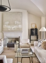 A monochromatic color palette in the living room projects a calm demeanor. Lambswool satin, glazed linen and an outdoor cut velvet add interesting texture.