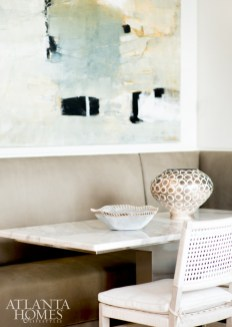 Kasler elevated the breakfast nook with Gregorius Pineo chairs and an abstract painting by Jeane Myers.