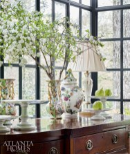 A selection of the homeowner's Meissen porcelain tops an antique sideboard from William Word Fine Antiques.