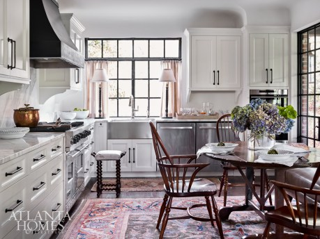 The renovated kitchen features new plasterwork, a coved ceiling and a custom vent hood designed by Pak Heydt & Associates and produced by Calhoun Design & Metalworks. The white bowls and pottery is from Dixon Rye. The copper pot is from Foxglove Antiques & Galleries.