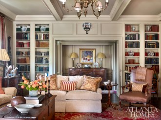 Warmth envelops the family room with understated reds, browns and beiges. The Italian leather chair is from Jacqueline Adams Antiques.
