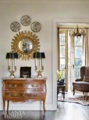 A grouping of famille rose porcelain mixes with other prized antiques in a corner of the living room.