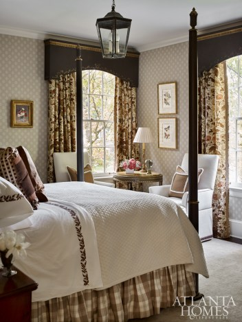 For the guest bedroom, Bryan reused curtains that once hung in the family room and commissioned cornices with gilded detailing to match the newly painted poster bed.