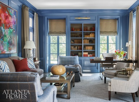 Lacquered paneled walls are balanced by textural fabrics, which include draperies and roman shades made of wool from Holland & Sherry with a cut velvet trim from Cowtan & Tout. The desk is Julian Chichester.