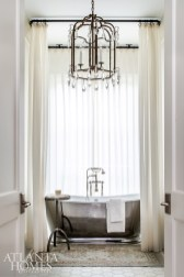 Because the bathtub is the first thing one sees when entering the master bathroom, Bozeman decided to soften the effect and create privacy by installing sheers on a drapery rod that runs around the entire perimeter of the tub.