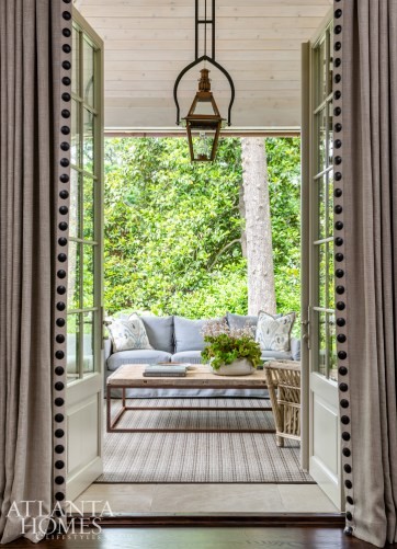Essentially an extension of the library, the porch, where the homeowners love to spend time, features retractable screens that extend down, allowing them to use the space much of the year.