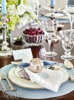 Bosbyshell helped her client style the table for the holidays, incorporating treasured dishware, antique silver and napkins and place mats from Gramercy Fine Linens & Furnishings. The walnut table is from Hickory White and the upholstered chairs from Hickory Chair.