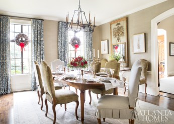 A Schumacher grasscloth adds texture to the dining room walls. The chair slipcover fabric is by Carleton V and the Oushak rug is Moattar. The silver pedestal basket is from Beverly Bremer.