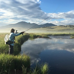 A fisherman enjoys miles of private water along the Tarryall River.