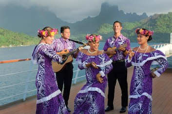 Les Gauguines and Les Gauguins entertain guests aboard a Paul Gauguin cruise in French Polynesia.