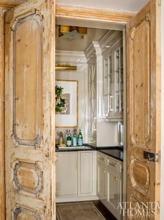 Reclaimed Italian doors reveal a butler's pantry.