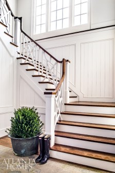 While an unexpected Chippendale-style railing on the home's center staircase adds flair, butted board walls instantly dial back the formality, a yin and yang design sensibility present throughout the house.