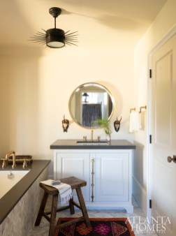 The guest house bathroom is open-concept, making the space appear larger. The vanity was custom designed by Johnson; the faucet is Brizo by Delta.