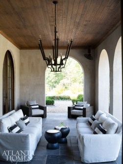 An outdoor seating area off the living room offers views of the rear landscape.